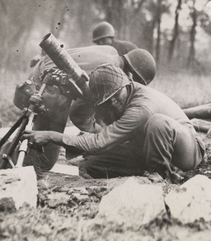 Business is Booming in Italy, Members of a Negro Mortar Company of the 92nd Division Praise the Lord [lines from captioned press photo]. Wide World Photo, Office of War Information.