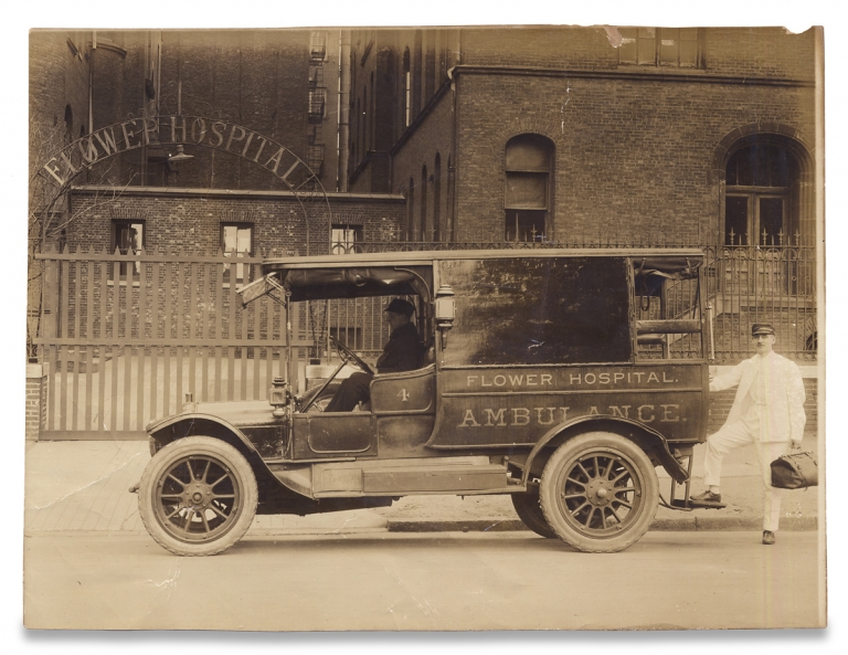 """[C.1910s Photograph of New York City's """"Flower Hospital"""" Ambulance at the Homeopathic Hospital's Archway Entrance]. Unkwn."""