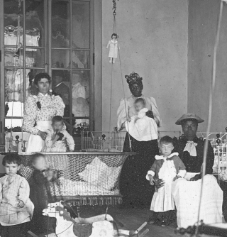 Glass Lantern Slide Showing African American Women Caretakers in a Day Nursery with White...